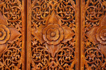 Pattern of flowers carved on wood