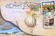 Leinwandbild Motiv Old postcard with stamps and blue sky