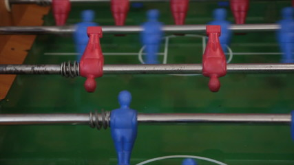 playing with foosball table game