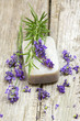 bar of natural soap and lavender flowers