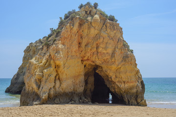 Rock with cave in the ocean