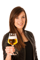 woman hilding glass of beer in her hands