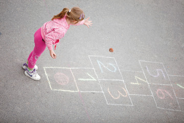 yong little  girl on the hopscotch