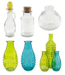 Assorted glass bottles and bowls on white