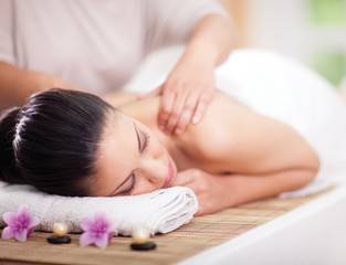Beautiful woman having a wellness back massage
