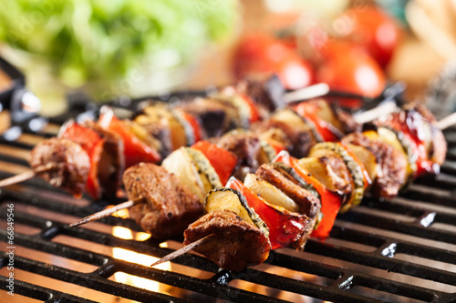 Foto op Canvas Vlees Grilling shashlik on barbecue grill