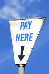 Triangular pay here sign © Arena Photo UK