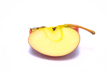 Apple one cut into peice on white background