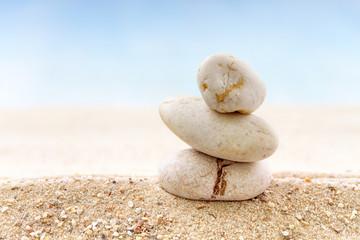 Stack of zen stones on sand beach