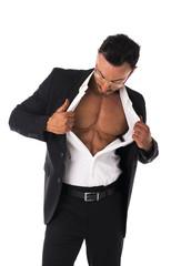 Businessman opening his shirt revealing muscular torso