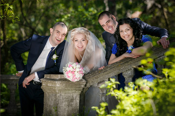 groom,  bride and the best man with the witness