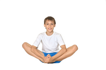 Teenage boy exercising yoga