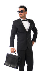 Attractive young businessman with suit and bowtie, isolated