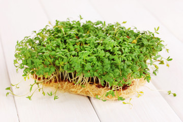 Fresh garden cress close-up on wooden table