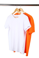 Orange and white t-shirts on hanger on white background