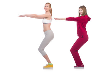 Pair of women doing exercises on white