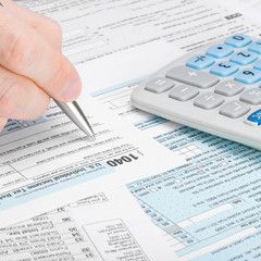 US Tax Form 1040 - man filling out tax form - 1 to 1 ratio
