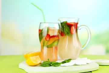 Basil lemonade with strawberry in  jug and glass,