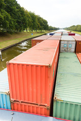 Containers on ship sailing in river