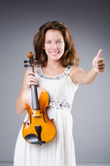Woman artist with violin in music concept