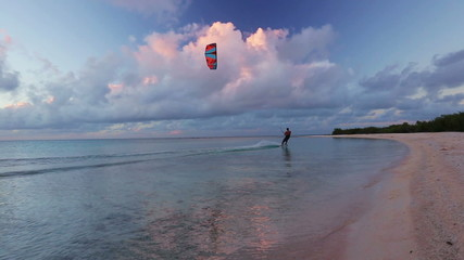kite surfing at sunset. fun in the ocean, extreme sport