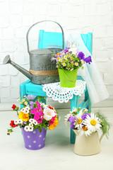 Bouquet of colorful flowers in decorative buckets,
