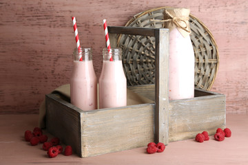 Bottles of tasty raspberry smoothie drinks
