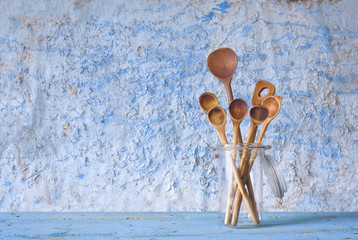 wooden spoons in a glass jar, cooking concept, free copy space