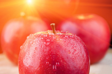 Red apple extreme closeup with flare