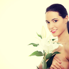 Spa woman with lily flower