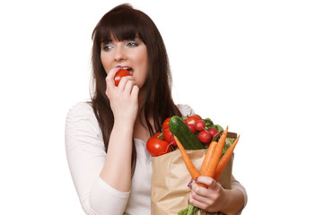 Young Woman with vegetables in shopping bag Diet Concept