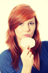 Young and beautiful woman with rice cake