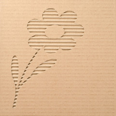 Flower cut out on a corrugated cardboard
