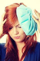 Woman with ice bag for headaches