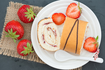Homemade cake roll with strawberry cream