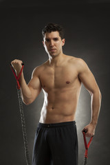 man doing fitness exercise with expander
