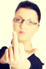Young woman with middle finger up