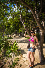 young woman with glasses standing near the tree. Koh Phangan