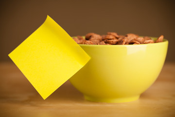 Empty post-it note sticked on cereal bowl