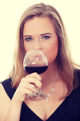 Elegant woman with glass red wine