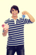Young man with key and piggybank.