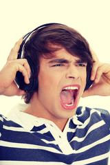Young man's singing with headphones.