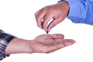 Close up of doctor hands giving a drug for patient