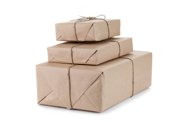 Cardboard carton wrapped with brown paper and tied with string
