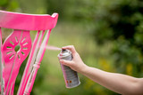 Spray paint an old chair pink - 66866753