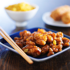 chinese food - orange chicken on blue plate