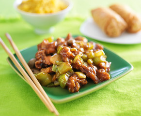 kung pao chicken on green plate.
