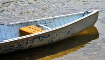small wooden boat on the water