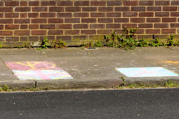 Chalk drawings on pavement