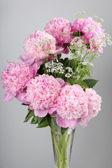 bouquet of pink peonies on a gray background